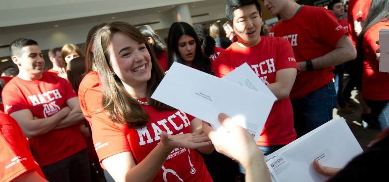 A fourth-year medical student receives her residency match letter at match day in 2016.