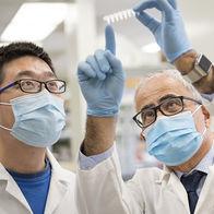 dr-khalili-examining-slide-in-lab