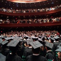Graduating medical students look into the crowd at the 114th commencement ceremony