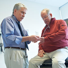 Gerard J. Criner, MD, FACP, FACCP, Chair and Professor of Thoracic Medicine and Surgery examines a patient.
