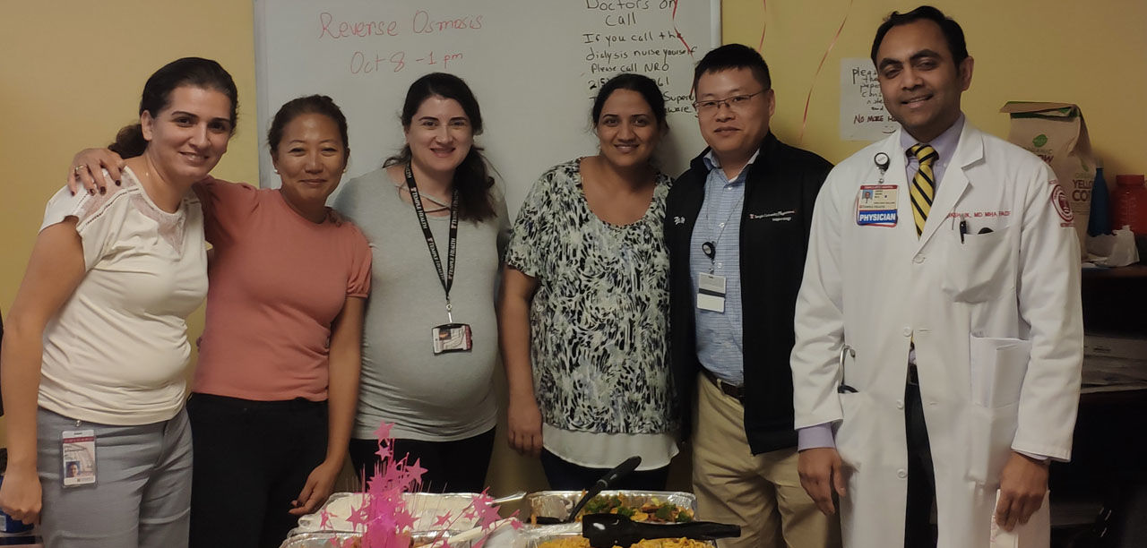 Fellows and faculty celebrating in the break-room at the inpatient dialysis unit